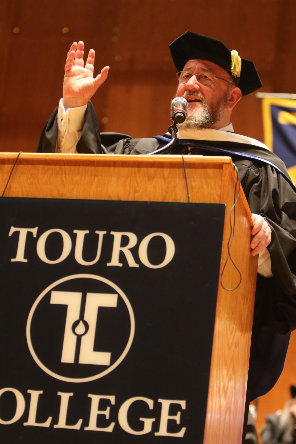 Rabbi Ephraim Mirvis, the Chief Rabbi of the United Hebrew Congregations of the Commonwealth of the United Kingdom, received an honorary degree at the 42nd annual commencement exercises of Touro College on Memorial Day.