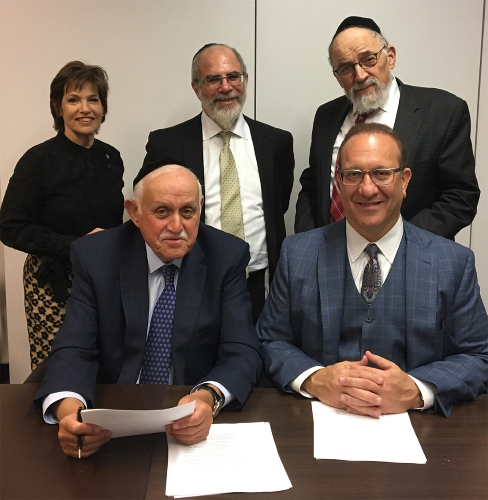 Front L-R, Dr. Robert Goldschmidt, Executive Dean at Lander Flatbush and Dr. Henry Cohen, Dean of Touro College of Pharmacy (TCOP). Back L-R, TCOP Assistant Dean for Admissions and Enrollment Management Heidi Fuchs, Lander Flatbush Dean Henry Abramson, and Touro Vice President of Undergraduate Education Dr. Stanley Boylan.